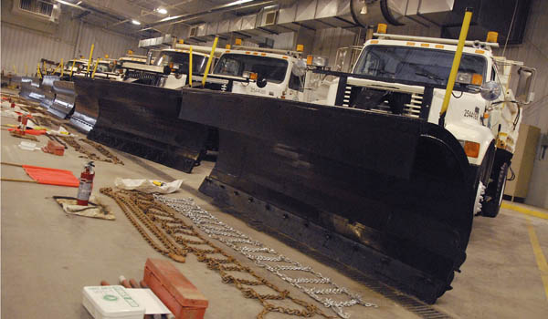 Row of plow trucks await inspection at the Ohio Department of Transportation garage in Ironton Friday. THE TRIBUNE/JESSICA ST. JAMES