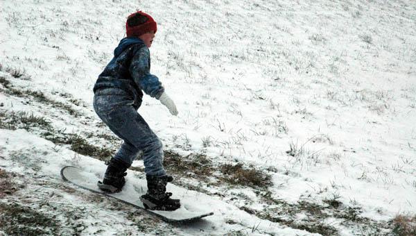 James Vallance, 12, of Ironton, snowboards down a hill. THE TRIBUNE/MICHELLE GOODMAN