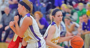 St. Joseph Female Flyers' guard Hannah Miller (right) drives to the basket using a screen set by teammate Hannah Martin during Thursday's Division IV district semifinal game against South Gallia. The Female Flyers lost 33-29. (Kent Sanborn of Southern Ohio Sports Photos)