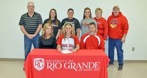 Rock Hill Redwomen junior pitcher Sami Nixon signed a letter-of-intent Friday to play softball for the University of Rio Grande. Attending the ceremony were: seated from left to right, mother Shawna Nixon, Sami and father Mark Nixon; standing from left to right, K.C. Diamond, Rio Grande assistant Carly Ivan, Rio Grande head coach Kristen Bradshaw, Rio Grande assistant Amber Bowman, Rock Hill head coach Mary Jane Harper and Rock Hill assistant coach Mark Harper. (Kent Sanborn of Southern Ohio Sports Photos)