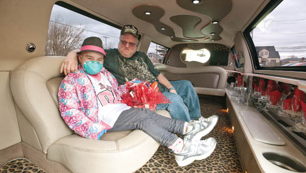 Eight-year-old Megan Foltz, with her father Jimmie, get comfortable in the back of a white stretch limousine from Classy Limousine following her trip back from Cincinnati Children's Hospital. With the exception of the occasional visit Megan is back home in the Burlington area to stay after her second battle with AML, or acute myeloid leukemia.