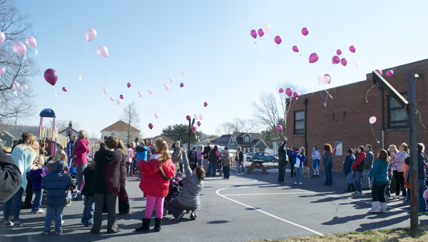 Students, faculty and staff of Open Door School released balloons into the air to celebrate the start of Developmental Disabilities Awareness Month on Monday in Ironton.
