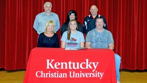 Rock Hill Redwomen senior Tommi Butler signed a letter-of-intent to play volleyball at Kentucky Christian University. Attending the ceremony were: seated from left to right, mother Brenda, Tommi and father Robert; standing from left to right, athletic director Bob Wilds, Redwomen head coach Mary Ferguson and KCU head coach Bruce Dixon. (Kent Sanborn of Southern Ohio Sports Photos.com)