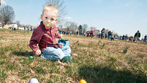 Three-year-old Trenton Fletcher casually picked up eggs with his Thomas the Train bucket at the easter egg hunt at the Lawrence County Fairgrounds Saturday.