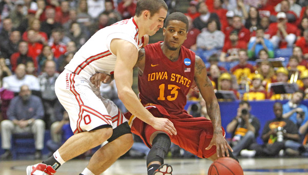 Ohio State guard Aaron Craft (4) looks to steal the ball away from Iowa State guard Korie Lucious (13) during first-half action in the third round of the NCAA Tournament at Dayton Arena in Dayton, Ohio, Sunday. Ohio State defeated Iowa State, 78-75. (MCT Direct Photo)