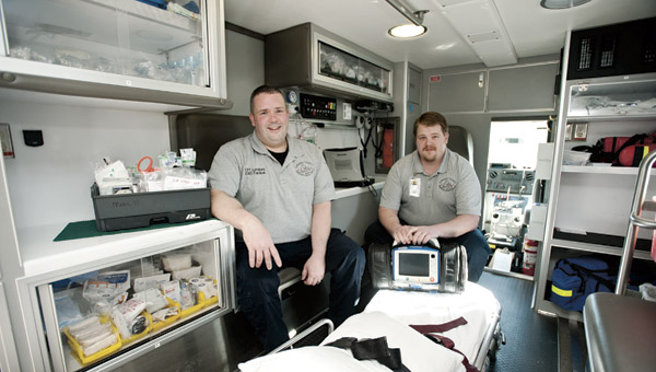 Partners Pete Lunsford and David Zornes are seen inside one of the Lawrence County Emergency Medical Services ambulances.