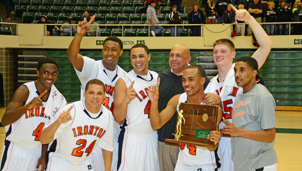 The Ironton Fighting Tigers' senior basketball players celebrate their Division III regional championship along with head coach Mark LaFon. The Ironton seniors are, from left to right, Darrius Boykin, Jalen Schweickart (24), Trey Fletcher, Trevor White, LaFon, Josh Glover, Aaron Stephens and Zac Carter. (Kent Sanborn of Southern Ohio Sports Photos.com)