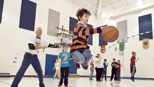 Braxton Horn jumps double Dutch and dribbles a basketball at the same time during the Jump Rope for Heart event at Burlington Elementary.