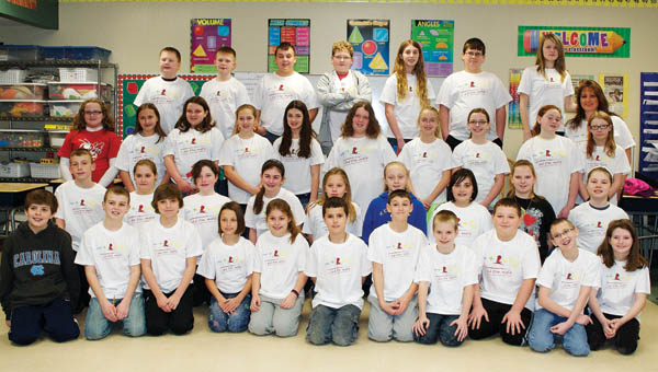 Coal Grove Elementary School students wear shirts they earned by participating in the school's Math-A-Thon.