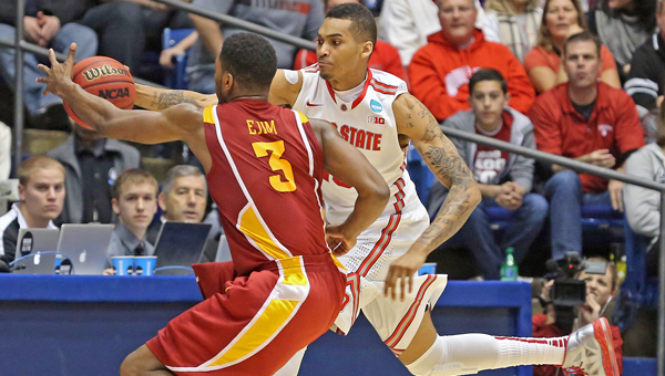 Ohio State Buckeyes forward LaQuinton Ross (10) saves a ball from going out against Iowa State Cyclones forward Melvin Ejim (3) during the second half of a third-round game in the NCAA Tournament at Dayton Arena in Dayton on Sunday. Ohio State defeated Iowa State, 78-75. (MCT Direct Photo)