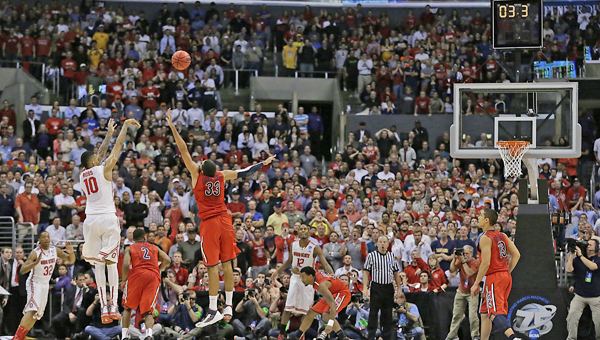 Ohio State's LaQuinton Ross (10) hits the game-winning 3-pointer in the waning seconds of a 73-70 triumph against Arizona in the NCAA Tournament Sweet 16 game at Staples Center in Los Angeles on Thursday. (MCT Direct Photo)