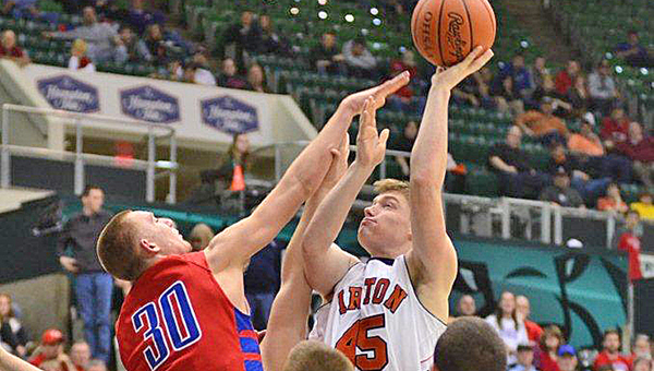 Ironton Fighting Tigers' center Aaron Stephens (45) hits a hook shot over a Zane Trace defender during the district tournament. Ironton plays Ottawa-Glandorf at 10:45 a.m. Thursday in the state tournament semifinals. (Kent Sanborn of Southern Ohio Sports Photos.com)