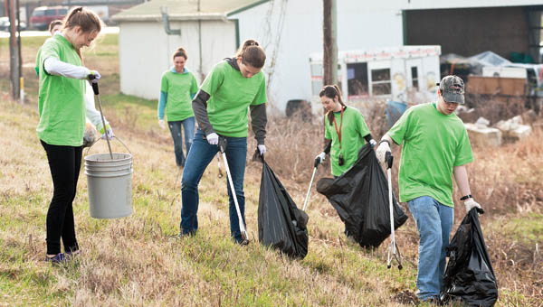 Students from Fairland High School spend their morning along State Route 7 cleaning up the roadway between Chesapeake and Proctorville.