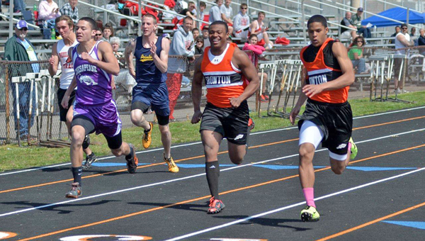 Ironton's Patrick Lewis (center) is all smiles but his teammate Jake Long (right) was even happier after winning the 100-meter dash at the 60th Ironton Invitational track meet on Saturday. Chesapeake's Javon Thompson (left) finished second. (Kent Sanborn of Southern Ohio Sports Photos.com)