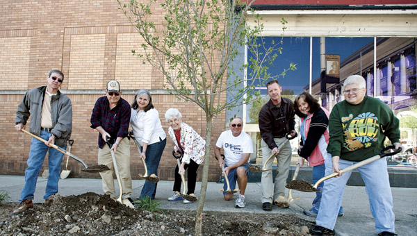 Members of Ironton In Bloom gather in downtown Ironton Friday to plant lilac trees in celebration of Arbor Day.