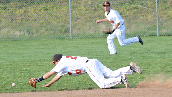 Ironton Fighting Tigers' shortstop Luke Diamond makes a diving stop of a ground ball during Tuesday's 4-0 win over Portsmouth. Outfielder Korey Kellogg backs up the play. (Tony Shotsky of Southern Ohio Sports Photos.com)