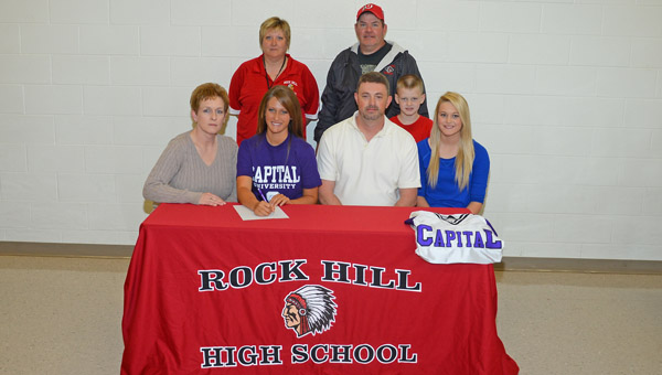 Rock Hill Redwomen senior Kaelynn Ellis signed a letter-of-intent to play softball at Capital University. Attending the signing ceremony are: front from left to right, mother Julie, Kaelynn, father Les, brother Nathaniel and sister Emmalee; Back row from left to right, Rock Hill head coach Mary Jane Harper and assistant coach Mark Harper. (Kent Sanborn of Southern Ohio Sports Photos.com)