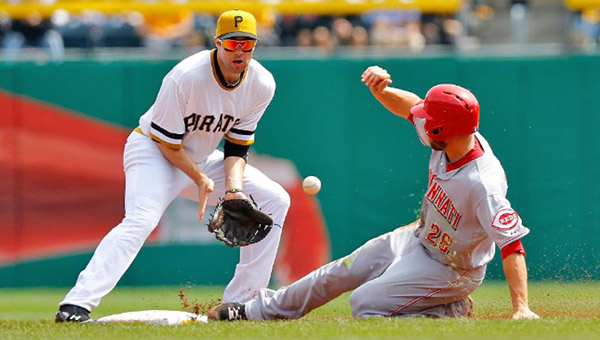 Cincinnati outfielder Chris Heisey (28) steals second base ahead of the tag by Pittsburgh's Neil Walker. Heisey's effort was wasted as the Reds lost their fifth straight game on Sunday, 10-7. (Courtesy of the Cincinnati Reds.com)