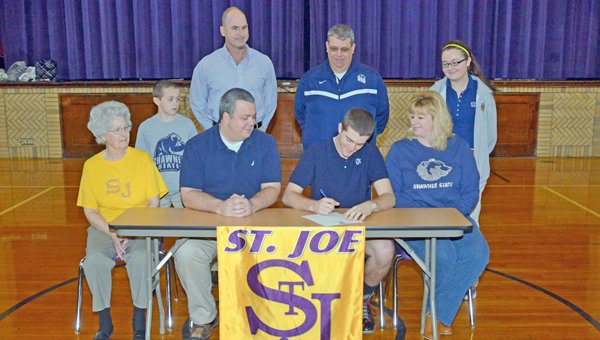 St. Joseph Flyers' senior goalkeeper Justin Mahlmeister signed a letter-of-intent to play for the Shawnee State University Golden Bears. Attending the ceremony were: seated from left to right, grandmother Wanda Mahlmeister, father Jimmy Mahlmeister, Justin, and Melanie Mahlmeister; standing from left to right, brother Jimmy, St. Joseph head coach Tim Hopkins, Shawnee State assistant coach Mark Trapp, and sister Morgan. (Tony Shotsky of Southern Ohio Sports Photos.com)