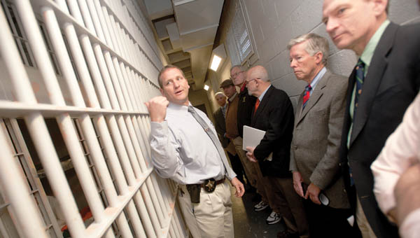 Lawrence County Sheriff Jeff Lawless gives various community leaders a tour of the county jail Tuesday morning.