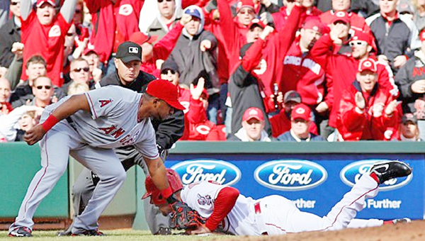 Cincinnati Reds' outfielder Ryan Ludwick slides safely into third base but suffers a dislocated shoulder in the process. The Reds lost their Opening Day game 3-1 to the Los Angeles Angels in 13 innings. (Photo Courtesy of The Cincinnati Reds.com)