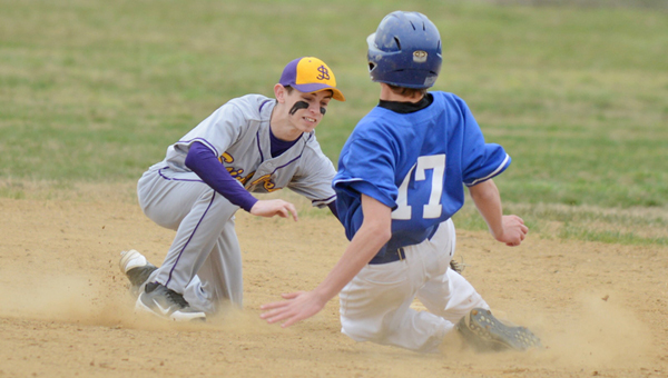 St. Joseph Flyers' Joseph Payton (left) tags out a Sciotoville East runner sliding into second base. The Flyers beat the Tartans 16-5 on Thursday. (Tony Shotsky of Southern Ohio Sports Photos.com)