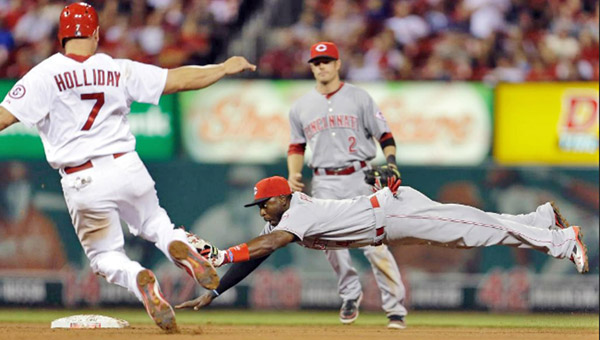 Cincinnati Reds' second baseman Brandon Phillips dives to beat St. Louis' Matt Holliday to the base on a force out for the final out of the fifth inning. The Reds beat the Cardinals 2-1 on Monday. (Photo Courtesy of the Cincinnati Reds.com)