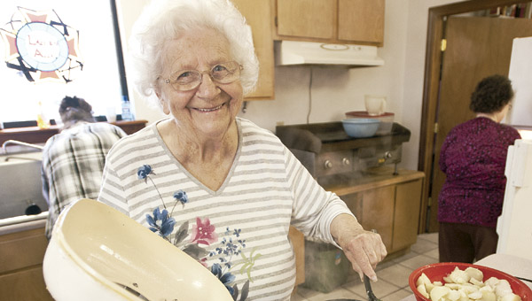 Hazel Clark, with the ladies auxiliary, cooks up a batch of ramps and potatoes during the annual dinner at the Proctorville VFW Post 6878 Saturday.