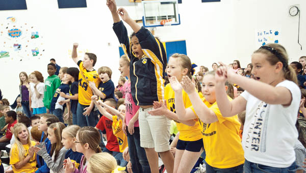 Students from Team Roberts jump up and down and scream as they are recognized during an academic pep rally at South Point Elementary School.