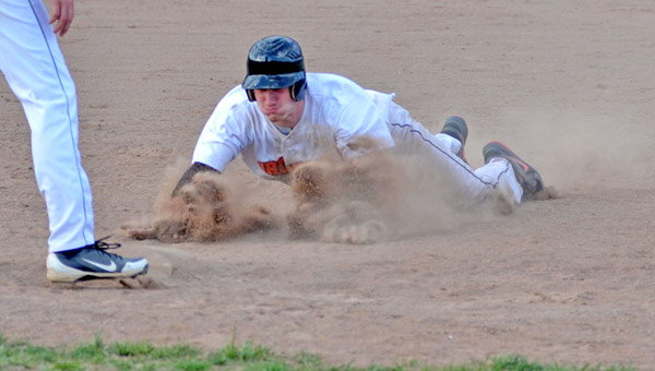 Ironton Fighting Tigers' Aaron Stephens kicks up the dirt as he does a head-first slide into third base. Stephens had two hits and scored three runs as Ironton beat Green 12-2. (Kent Sanborn of Southern Ohio Sports Photos.com)
