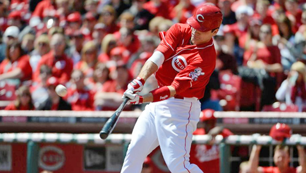 Cincinnati first baseman Joey Votto connects on a home run during the first inning of Sunday's game. Votto had three hits as the Reds beat the Miami Marlins 10--6. (Courtesy of the Cincinnati Reds.com)