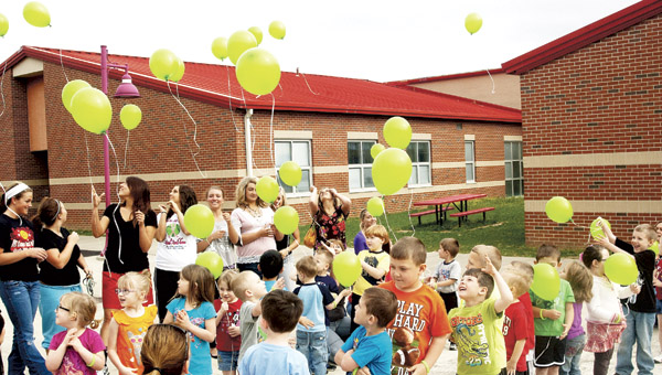 Preschool children at Rock Hill release balloons into the air Monday for the start Week of the Young Child.