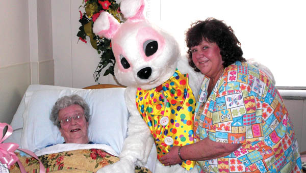 The Easter Bunny visits with Sanctuary of the Ohio Valley resident, Johanna Meeks, right, and facility beautician, Joanie Nelson during a visit to the Sanctuary for its first ever Easter egg hunt event.