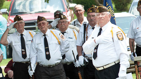 Members of the VFW 6878, of Proctorville, stand at attention during the Pledge of Allegiance during a special recognition of Armed Forces Day Saturday.