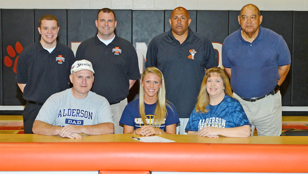 Ironton Lady Fighting Tigers' senior basketball standout Alicia Murphy signed a letter-of-intent to play at Alderson-Broaddus College. Attending the signing ceremony were: seated from left to right, father D.J. Murphy, Alicia and mother Rhonda Murphy; standing from left to right, assistant coach Cory McKnight, head coach Doug Graham, athletic director Mark LaFon and assistant coach Danny Pride. (The Ironton Tribune / Kent Sanborn of Southern Ohio Sports Photos.com)