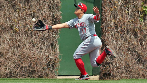 Cincinnati Reds' centerfielder Shin-Soo Choo runs as he attempts to catch a ball hit by the Chicago Cubs' David DeJesus during Sunday's game in Chicago. The Reds won 7-4. (Photo Courtesy of The Cincinnati Reds.com)
