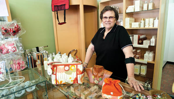 Rowena Mollett shows off some of the gift items at her new shop, Downtown Emporium, located in downtown Ironton.