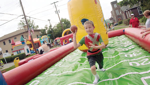 Dylan Bok, of Billard, takes part in the bungee run while at the 2012 Catholic Schools' Charity Fair in Ironton.