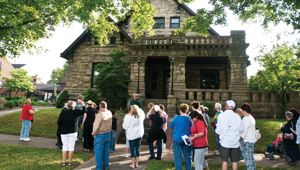 Eventgoers gather in front of 504 S. Fifth St. at the former home of irontonmaster Nanny Kelley Wright.