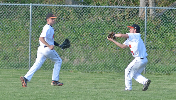 Ironton outfielder Korey Kellogg (right) chases down a fly ball for an out. The Fighting Tigers beat the Coal Grove Hornets 9-4 on Wednesday in the Division III sectional tournament. (Kent Sanborn of Southern Ohio Sports Photos)