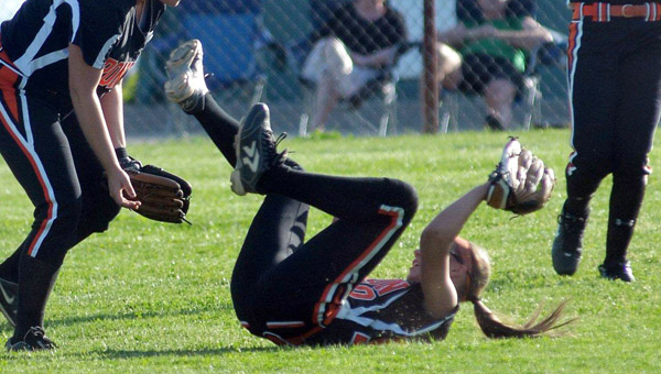 Ironton Lady Fighting Tigers' second baseman Andi Kratzenberg makes a diving catch in Wednesday game at Fairland. Ironton won 3-1. (Kent Sanborn of Southern Ohio Sports Photos.com)