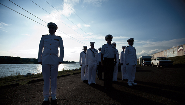Members of the Navy Operational Support Center Eleanor in West Virginia stand at attention during the post of colors at the annual Navy Night Memorial Service event Thursday at the Center Street Boat Landing in Ironton.