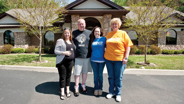 The Necco staff at its new location at 178 Private Drive 19423 in South Point, located off of U.S. 52. Pictured, left to right, are Jennifer Graham, state director; Greg Thompson, program director; Stephanie Vanover, therapist; and Teresa Rickman, home resource coordinator.