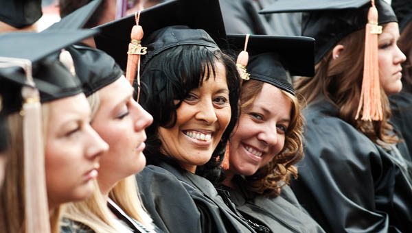 Kalynda Cloud, center, enjoys the graduate recognition  program and reception at Ohio University Southern Friday.