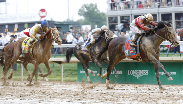 Orb, with Joel Rosario up, captures the 139th running of the Kentucky Derby at Churchill Downs in Louisville, Kentucky, on Saturday. (The Ironton Tribune / MCT Direct Photos)
