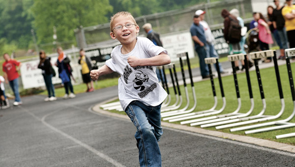 Dawson-Bryant Elementary School student Levi Kingery competes in the 50 meter dash during the Lawrence County Special Olympics Wednesday at Dawson-Bryant High School.