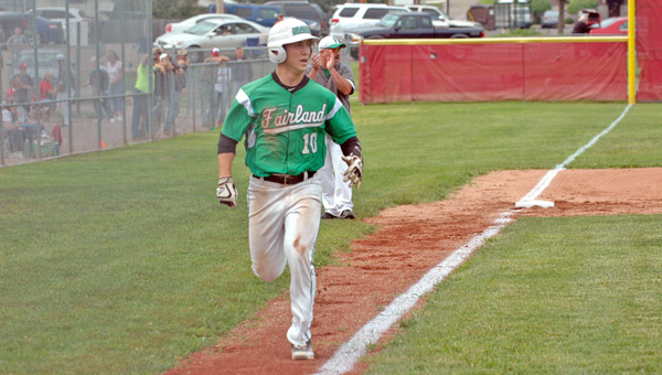 Fairland's Kyle Sowards scores in the first inning during Thursday's Division II sectional tournament finals. Jackson came back to win 6-2. (Photo Courtesy of Paul Boggs of the Jackson Times-Journal)