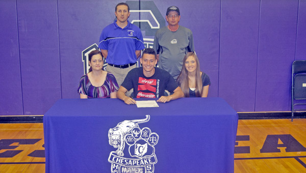Chesapeake Panthers' senior Javon Thompson signed a letter-of-intent to play football at Kentucky Christian University. Attending the signing ceremony were: seated from left to right, mother Tara Thompson, Javon and friend Kierra Kerns; standing from left to right, Chesapeake head coach Andy Clark and football statistician Rusty Marcum. (The Ironton Tribune / Jimmy Walker)