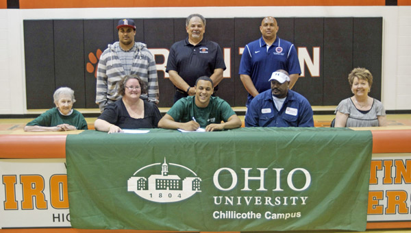 Ironton Fighting Tigers' All-Ohio senior basketball standout Trevor White signed a letter-of-intent with Ohio University Chillicothe. Attending the ceremony were: seated from left to right, grandmother Rosalie White, mother Jessica Fitzpatrick, Trevor, father Tim McMillan and Theresa Bowen; standing from left to right, brother Geoff White, OUC head coach Rick Uhrig and Ironton head coach Mark LaFon. (The Ironton Tribune / Jimmy Walker)