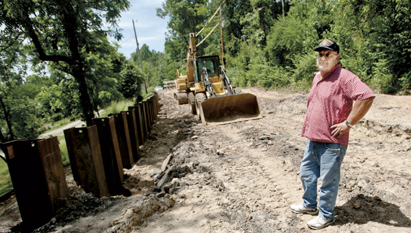 Area resident Dale Blakeman stands on a section of County Road 6 that is now blocked due to construction delays.